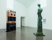 Installation view of Mark Leckey's BigBoxStatueAction, sound systems 'in conversation' with Henry Moore's Upright Motive No.9, 1979, Serpentine Gallery, London, 2011 - courtesy the artist and Cabinet, London, photograph by Mark Blower