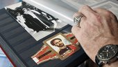 Close up of photo album showing Haile Selassie memorabilia