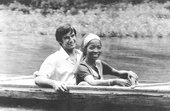monochrome photo of Jack Gerrity and Pacita Abad smiling on a boat