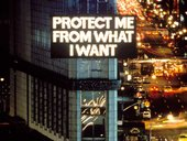 Electronic billboard over busy streets with words Protect Me From What I Want