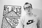 Keith Haring stood in front of a drawing