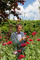 Monty Don stands in his garden