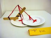 Kid's sculpture made from lolly sticks and a paper plate