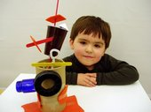 Boy with sculpture he has made