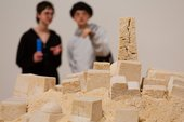 Visitors looking at Kada Attia's sculpture 'Untitled (Ghardaïa)' 2009 in the Living Cities display at Tate Modern