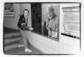 Keith Haring drawing on a subway platform, New York City, c1982