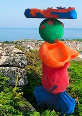 a plasticine-like scuplure, created digitally is situated in a beach landscape in St Ives