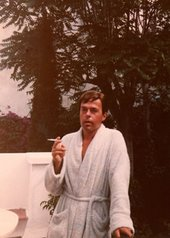 Image of Kenneth Halliwell smoking in his dressing gown