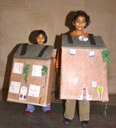 Kids wearing their house creations