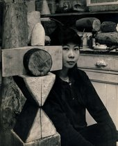 Photograph of artist Kim Lim with her sculpture 'Chess Piece'