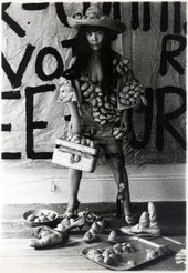 Yayoi Kusama wearing an outfit from her collection
