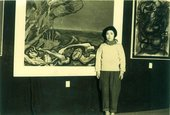 Kusama standing in front of Lingering Dream, selected for the Second Creative Arts Exhibition in Nagano, 1951 Courtesy Yayoi Kusama Studio, Inc