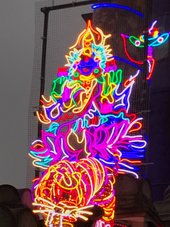 Goddess Lakshmi sitting on a lotus flower, made out of neon