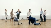 photograph of people dancing in a white gallery space