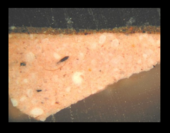 Fig.5 Cross-section through brown paint at the lower left edge, photographed at x260 magnification.