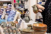 a person holds some pottery in the tate st ives shop