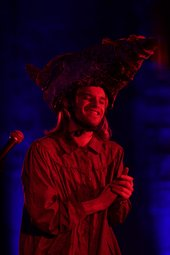 A person performing in a dark setting