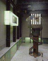 Tower-like metal sculpture in turbine hall