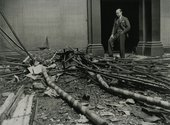 Director of the Tate Gallery John Rothenstein stands in rubble in the Tate Galleries