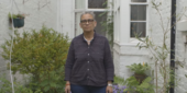 an image of Lubaina Himid standing in front of a house