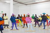 Lubaina Himid 'Naming the Money' 2004 a series of colourful cut out figures are places in a white walled gallery space