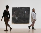 two people are walking away on either side of a Lynette Yiadom-Boakye piece called The Generosity