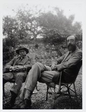 Photograph of Clive Bell and Lytton Strachey in the garden at Charleston © Tate Archive