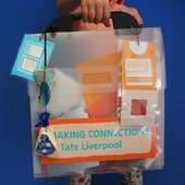 Student holding an activity pack