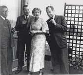 Marcel Breuer, Ise Gropius and Walter Gropius celebrating the first anniversary of the Isokon Flats on the building's rooftop, Lawn Road, Belsize Park, London, 1935
