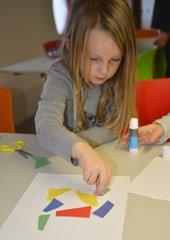 Kid arranging shapes