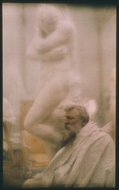 Colour photograph of Auguste Rodin in front of his plaster model