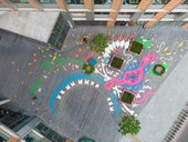 birds eye view of a mural of abstract shapes painted on the ground