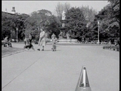 A park with a child riding a tricycle