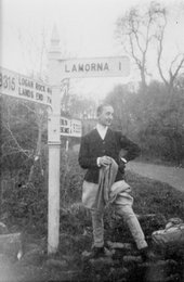 Marlow Moss in front of Lamorna sign