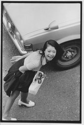 Masahisa Fukase's photograph, From Window 1974 showing a young woman carrying a suitcase photographed from above