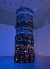 A large tower of individual radios lit with blue light