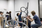 Kids working with bendy sculptures