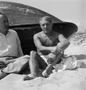 Black and white photograph of Picasso on the beach.