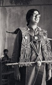 Mrinalini Mukherjee wearing one of her fibre works in 1969, photo by Jyoti Bhatt