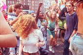 Photograph of Ravers protesting on the streets and dancing