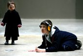 Kid wearing headphones doing the Making your Mark activity at Tate Modern