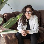 Nadira Amrani sitting on a couch