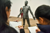 Young people from the National Saturday Club sketching Antony Gormley's 'Untitled (for Francis)'