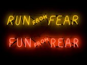 Neon sign reading 'Run from Fear', 'Fun from Rear'