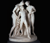 Sculpture of three marble figures on black background