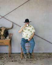 Bruce Nauman sits on a chair in his home and sips a coffee