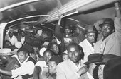 A Black-only commuter train carriage: 'All stand packed together on the floors and seats.'