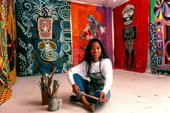 photo of Pacita Abad surrounded by her artworks