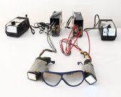 a pair of blue goggles and electronic wiring