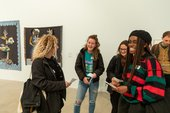 A group gathered in a gallery space